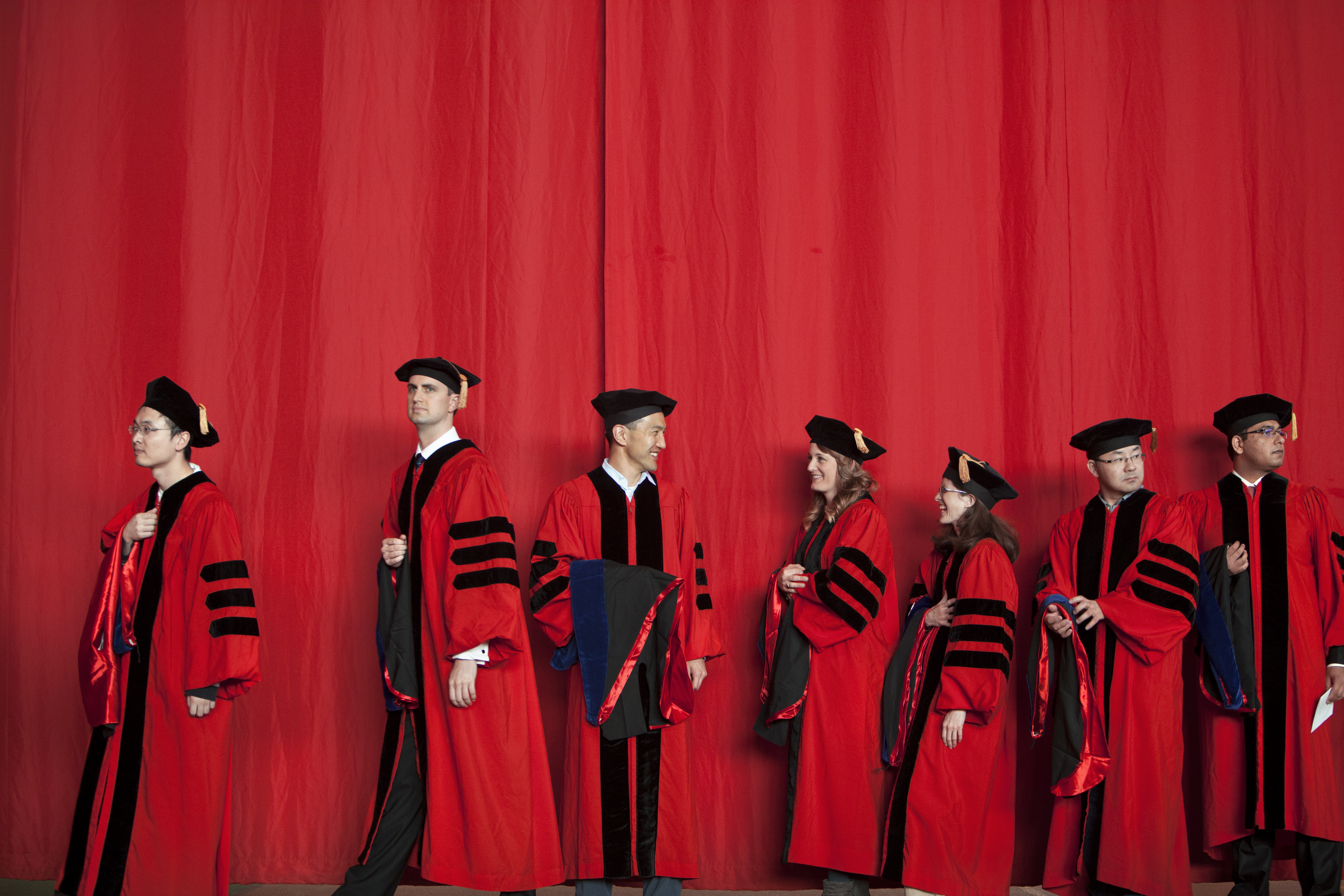 master students walking across stage
