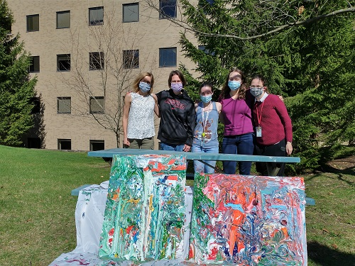 group photo of lab members with their new artwork