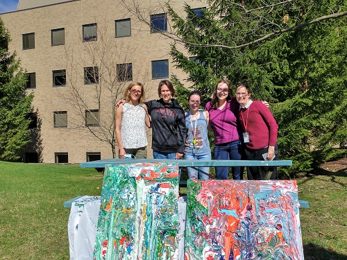 lab members with their new artwork