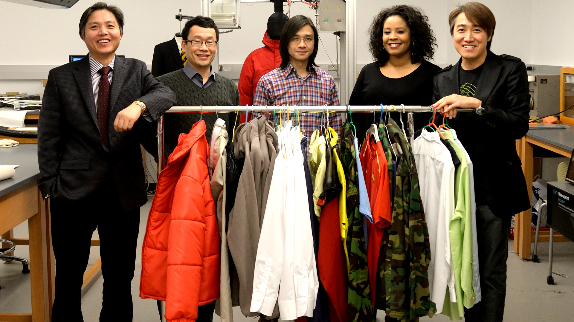 faculty with a rack of thermo clothing