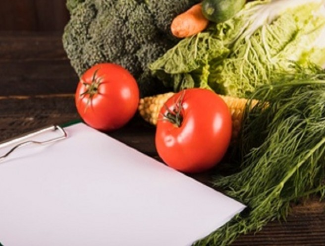 clipboard with vegetables