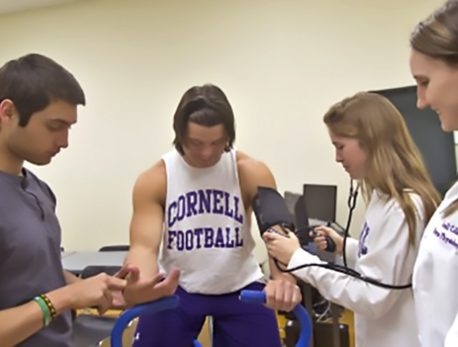 students measuring blood pressure while exercising