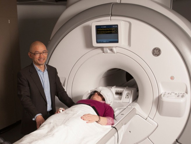 researcher with subject at fmri