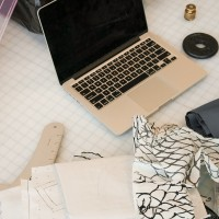 Fashion Design student's laptop and fabric on a table