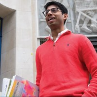 College of Human Ecology student carrying books during study abroad in London