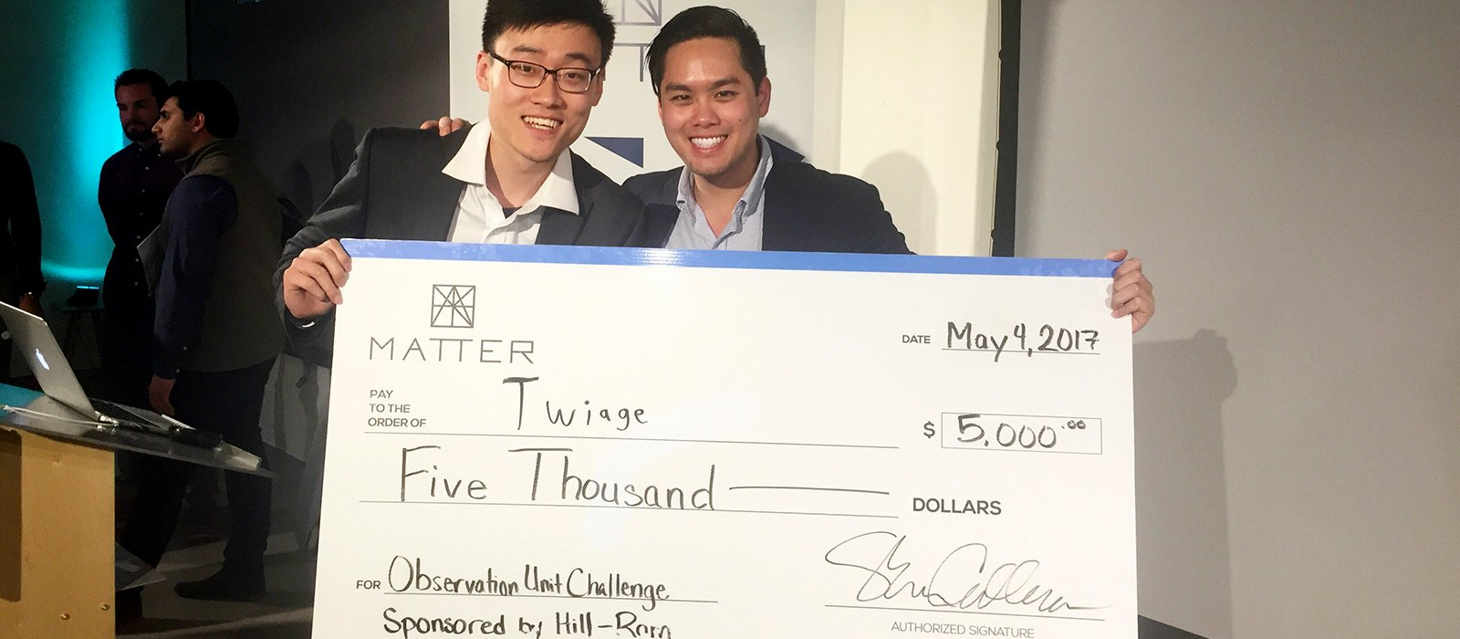 Oude Gao and Chris Than receive check for $5,000