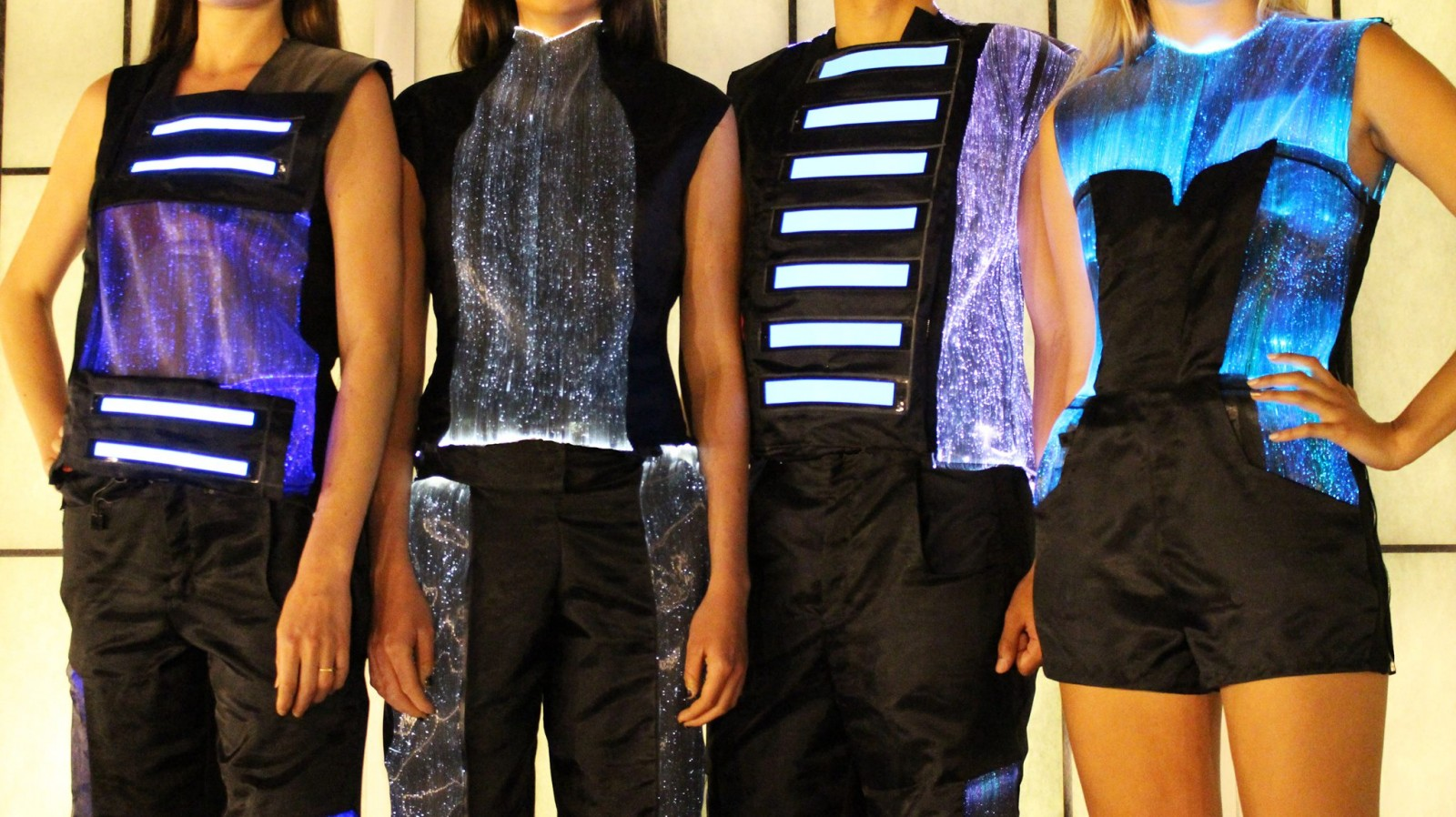 Models wearing LED lit clothing.