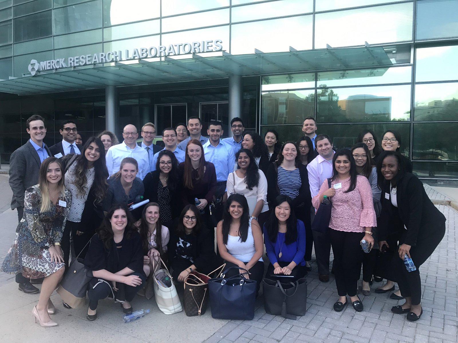 Sloan, students visiting the Merck research laboratories