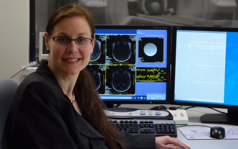 Professor Valerie Reyna in the control room of the MRI