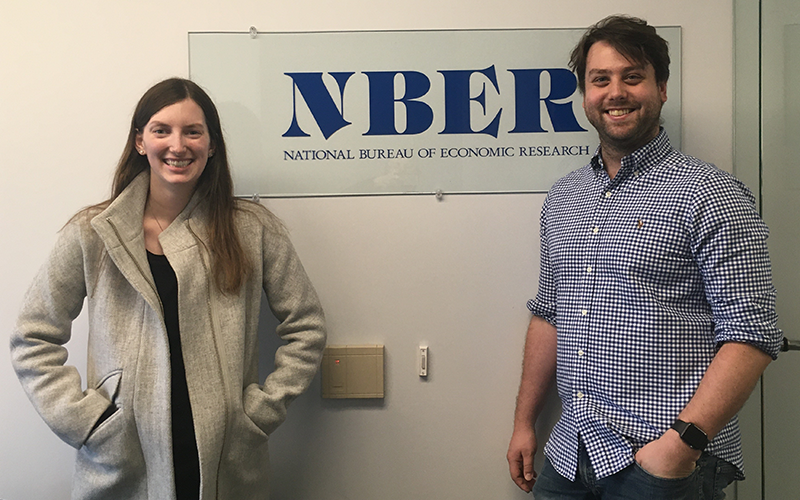 Ph.D. Students in front of NBER sign