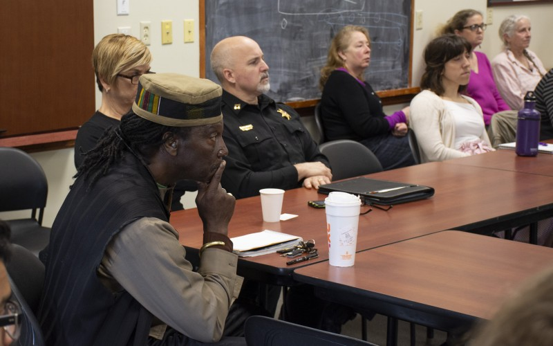 Community participants listen to the student presentations